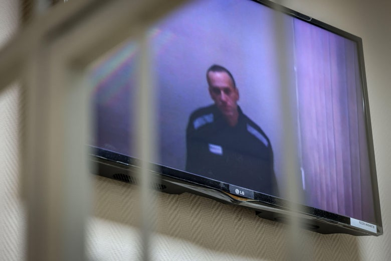 Russian opposition politician Alexei Navalny appears on screen via a video link from prison during a court hearing on May 26, 2021.
