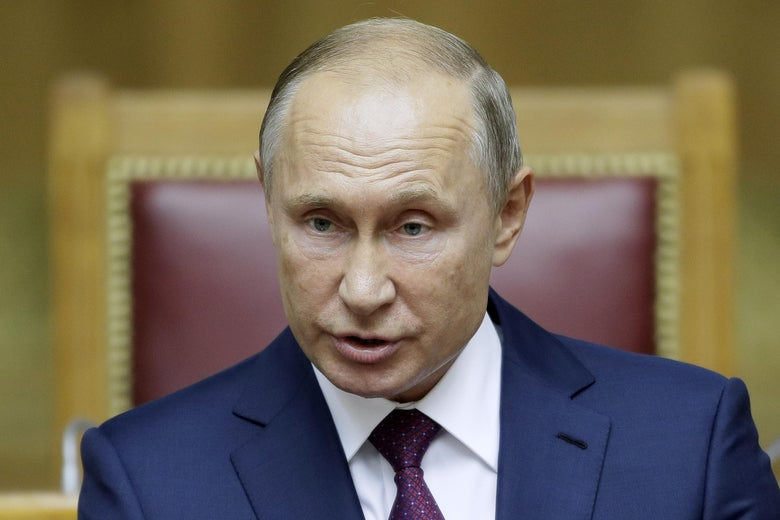 Russian President Vladimir Putin speaks while wearing a suit