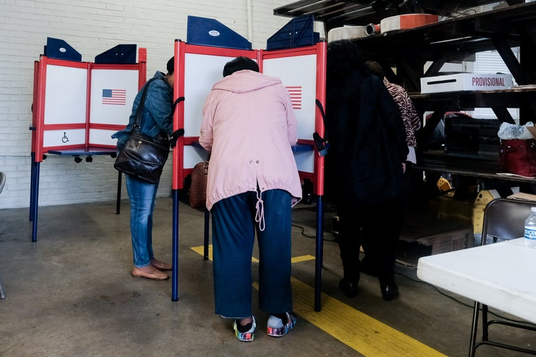 Voters huddled around voting booths to fill out their ballots