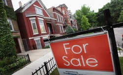 A 'For Sale' sign stands in front of a house on May 31, 2011 in Chicago, Illinois.