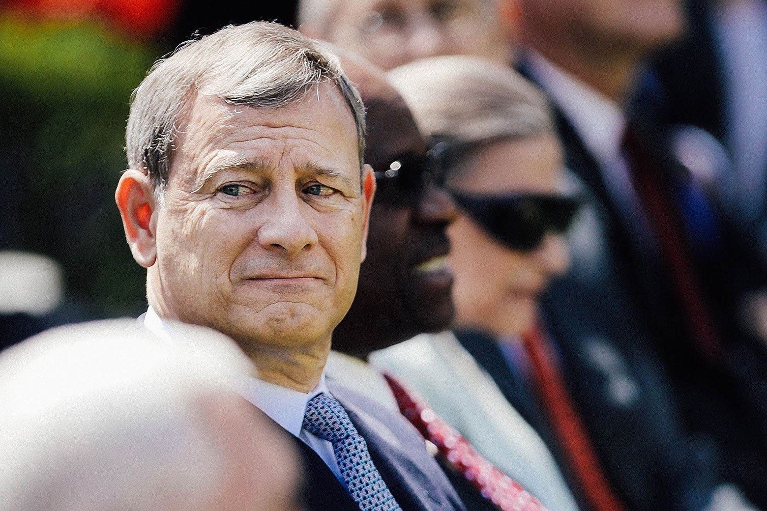 Chief Justice John Roberts sitting down