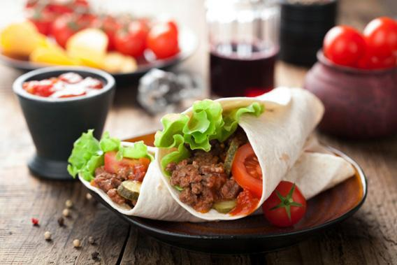 Tortilla wraps with meat and vegetables.