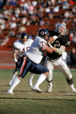 Defensive tackle William Perry #72 of the Chicago Bears battles against center Don Mosebar #72 of the Los Angeles Raiders.
