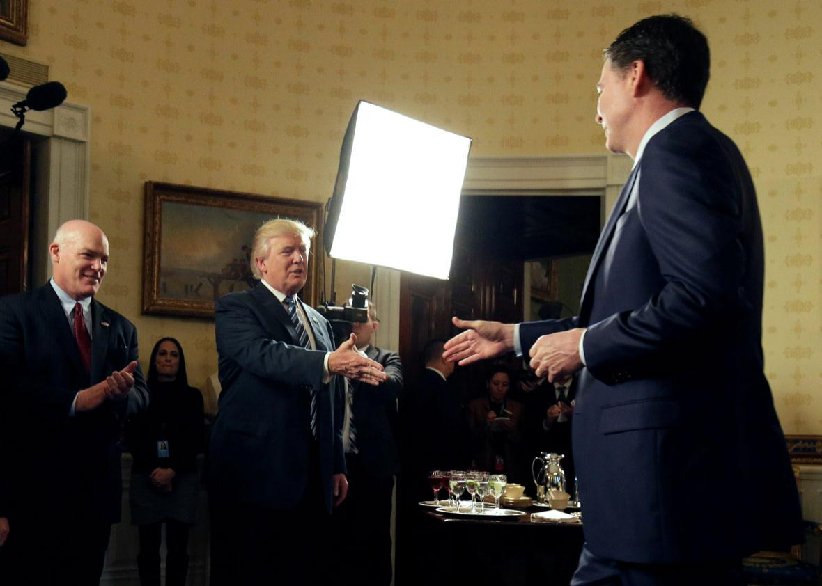 U.S. President Donald Trump greets Director of the FBI James Comey.