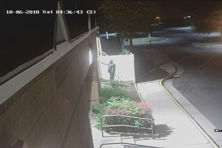 Security cameras captured images of a suspect spray-painting the swastikas on the Jewish Community Center in Fairfax County, Virginia on Oct. 6, 2018.