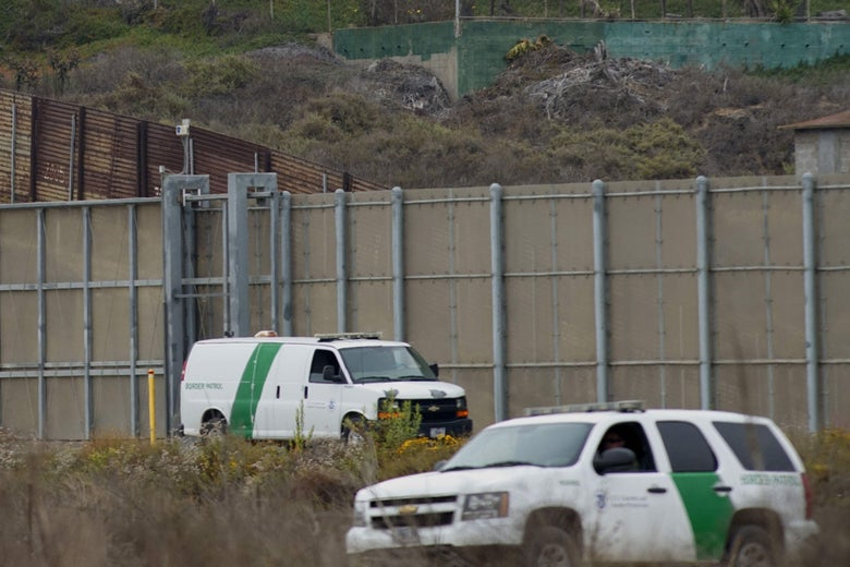 Border patrol cars are seen near the old border wall just east of Borderfield State Park where construction is set to begin on approximately 14.5 miles of new fencing on June 4, 2018 in San Ysidro, California.