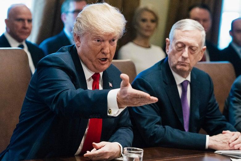 Donald Trump with Jim Mattis seated beside him.