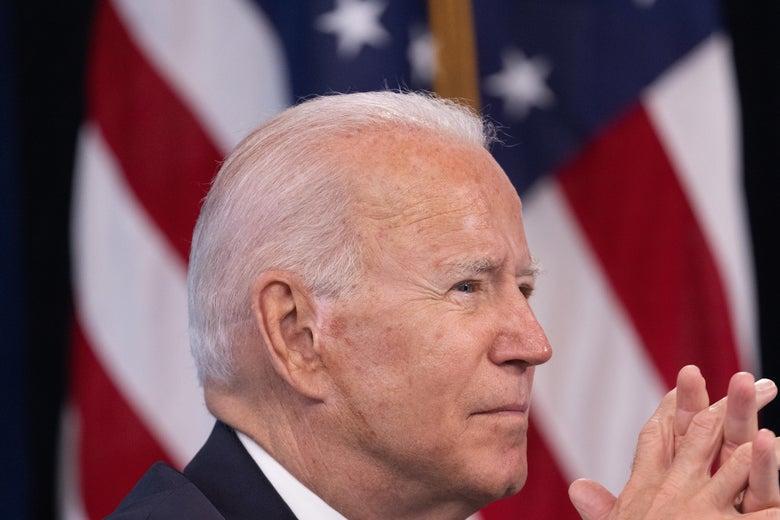 Biden cups his hands together.