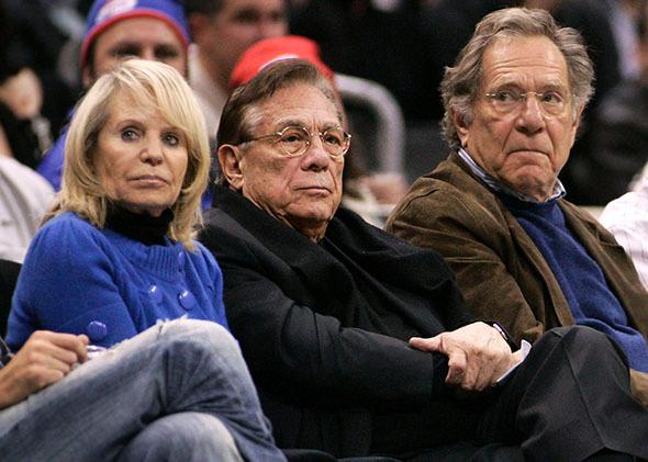 Los Angeles Clippers owner Donald Sterling (C), his wife Shelly (L) and actor George Segal.