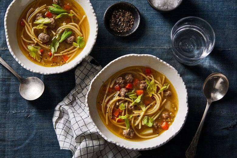 Clear broth soup with noodles, beef, and vegetables.