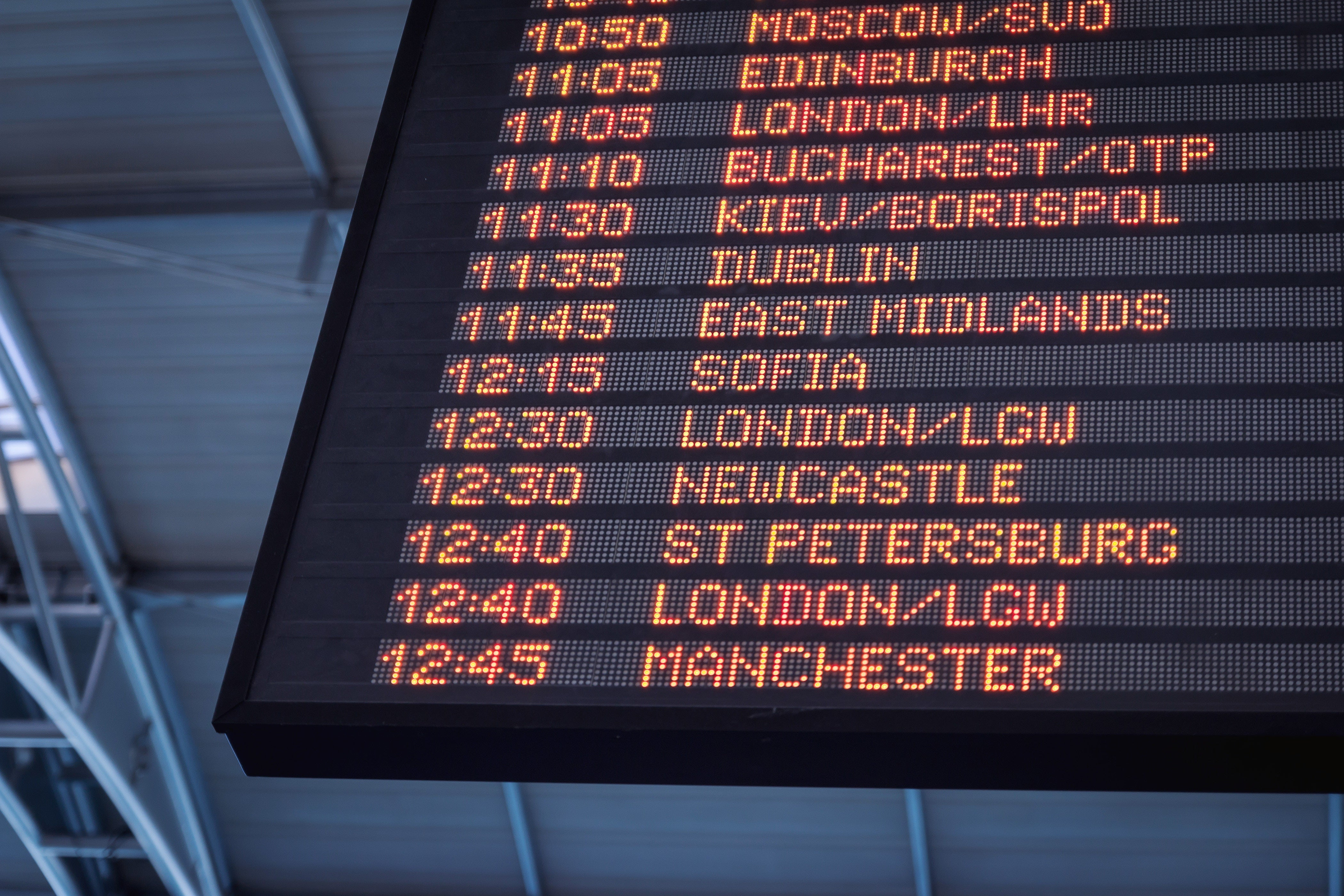 A departure board in an airport.