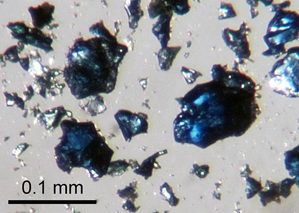 Crystals of blue hydrous ringwoodite like these, synthesized in a high-pressure laboratory experiment, were used to help identify the diamond inclusion originating in the mantle transition zone.