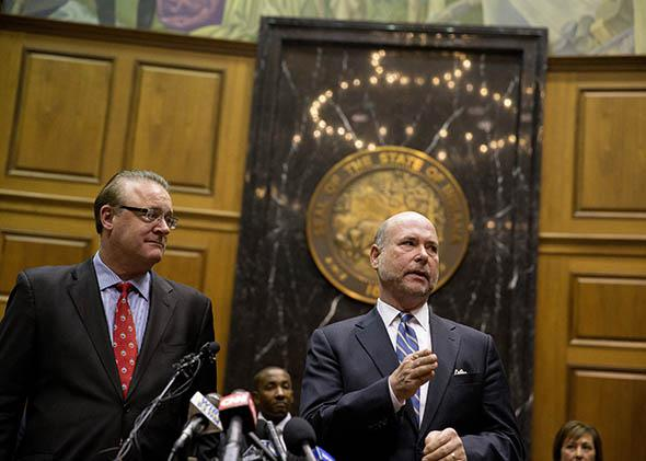 Indiana House Speaker Brian Bosma speaks as Senate President Pro Tem David Long (left) looks on during a press conference about anti-discrimination safeguards added to the controversial Religious Freedom Restoration Act on April, 2, 2015 at the State Capitol in Indianapolis.