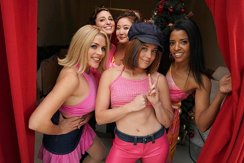 Five women in pink outfits.