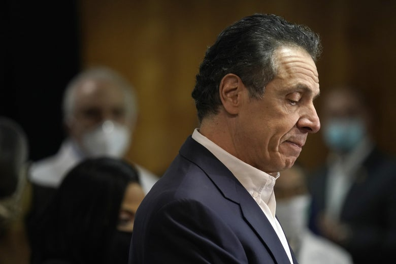 Cuomo in profile, looking down at his podium