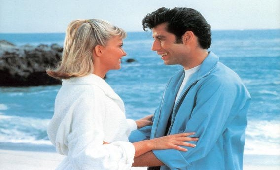 Olivia Newton-John and John Travolta on the beach in a scene from the film 'Grease', 1978.
