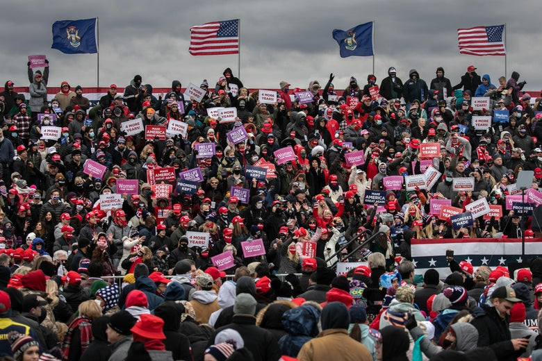 Supporters of President Donald Trump cheer at a campaign rally at Oakland County International Airport on October 30, 2020 in Waterford, Michigan.