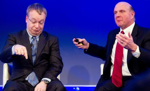 At a 2011 briefing annoucning Nokia's parternship with Microsoft, Nokia CEO Stephen Elop (left) presciently indicates which way his company's global smartphone market share is headed.