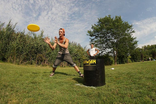 Two men playing the Kan Jam Ultimate Disc Game.