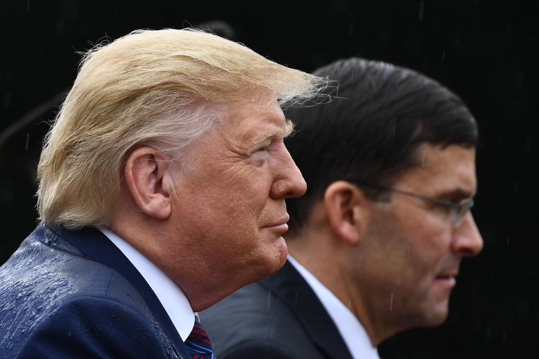 President Donald Trump and Secretary of Defense Mark Esper attend the Armed Forces Welcome Ceremony in honor of the Twentieth Chairman of the Joint Chiefs of Staff on September 30, 2019 at Summerall Field, Joint Base Myer-Henderson Hall, Virginia.