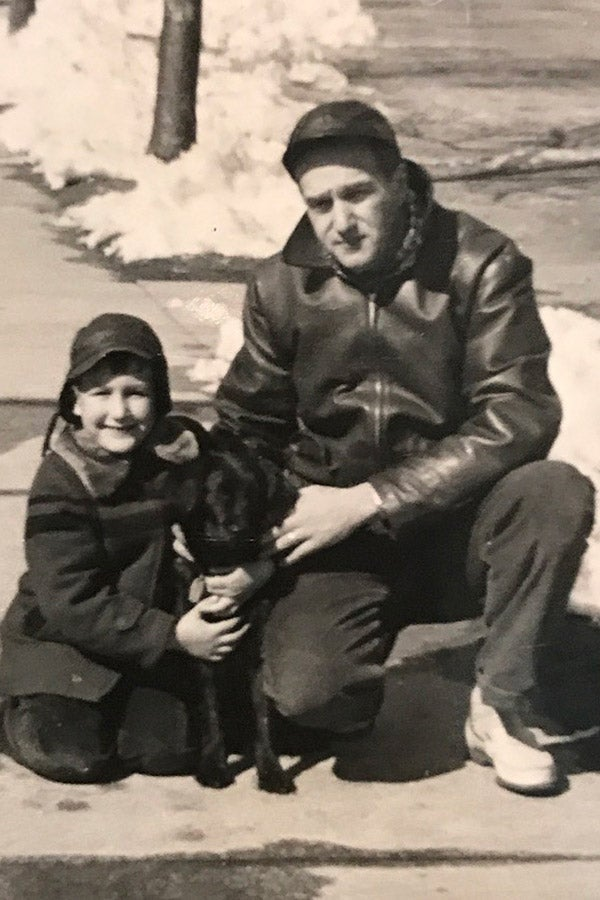 Hassan and his father in front of their house with a small dog in the 1950s.