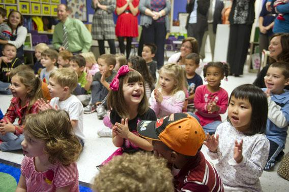 Students clap after Kathy Duritza, a pre-school teacher at the North Hills KinderCare Learning Center, is surprised with the Early Childhood Educator Award and a USD 10,000 check from Knowledge Universe on September 26, 2012 in Pittsburgh, Pennsylvania.