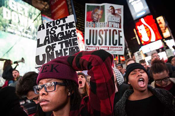 People protest in Times Square over the Ferguson grand jury decision to not indict officer Darren Wilson in the Michael Brown.