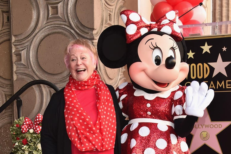 Russi Taylor, who has voiced Minnie Mouse since 1986, poses with Minnie Mouse at a Hollywood Boulevard star ceremony.