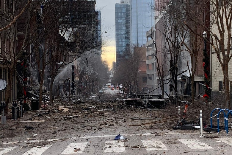 Branches and rubble strewn across a city street