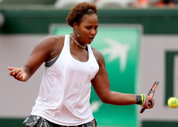 Taylor Townsend returns a shot during her match against Alizé Cornet of France.