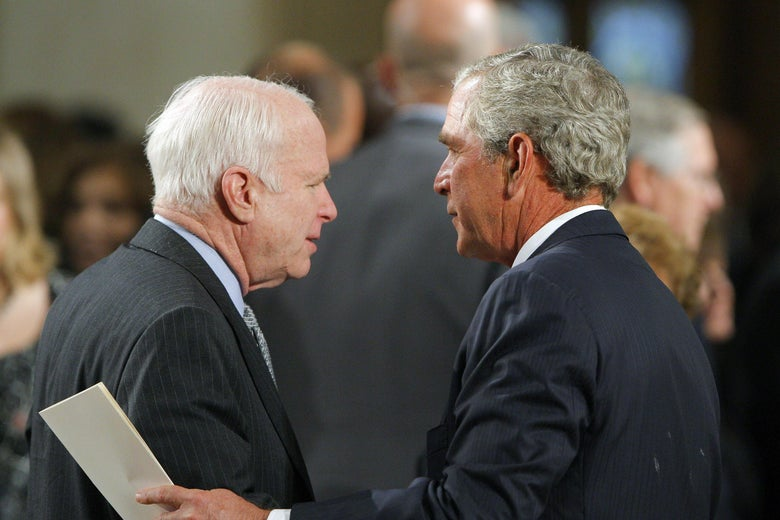 Senator John McCain talks with former US President George W. Bush as they await the start of the funeral services for Senator Edward Kennedy at the Basilica of Our Lady of Perpetual Help in Boston, on August 29, 2009.