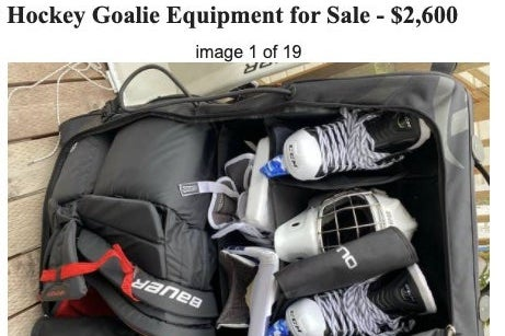 A bag of skates and other equipment for sale.