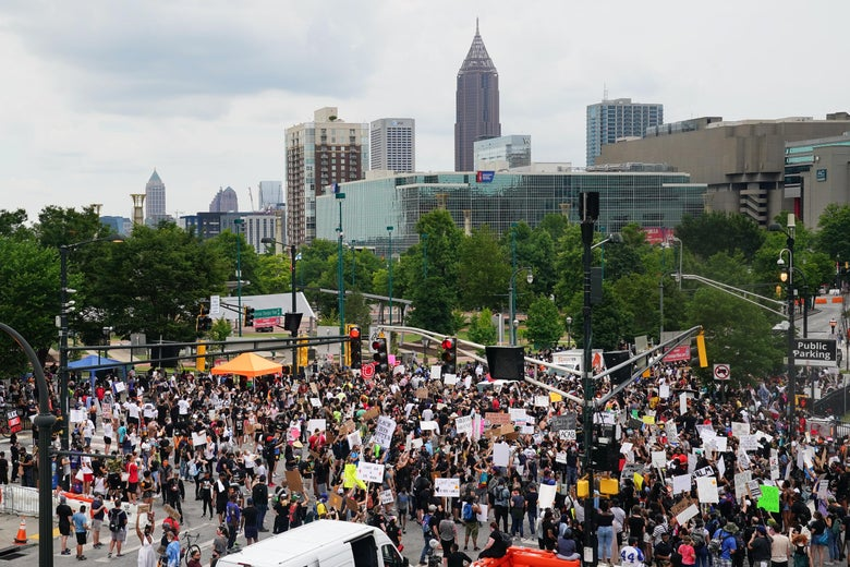 People gather during a protest against police brutality on June 6, 2020 in Atlanta.