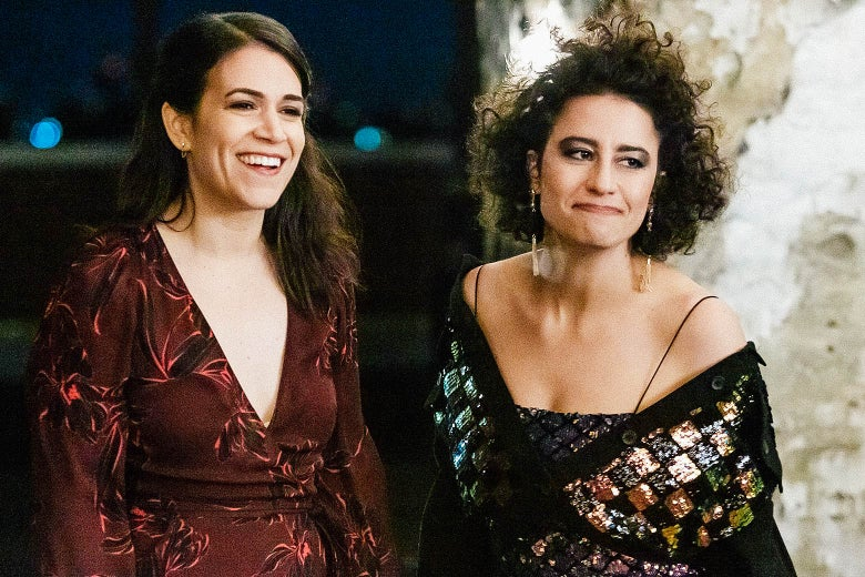 Abbi Jacobson and Ilana Glazer dressed for a party, in a scene from Broad City.
