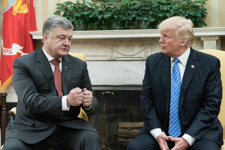 Petro Poroshenko and Donald Trump, seated in front of the fireplace in the Oval Office.