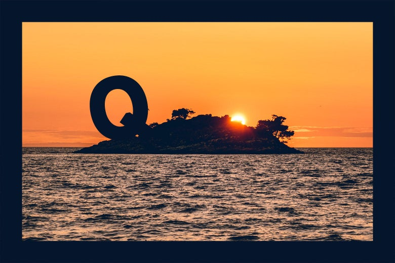 "A deserted island at sunset with a large letter ""Q"" on it."