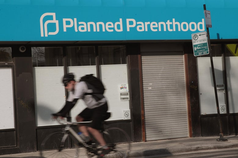 CHICAGO, IL - MAY 18:  A cyclist rides past a Planned Parenthood clinic on May 18, 2018 in Chicago, Illinois. The Trump administration is expected to announce a plan for massive funding cuts to Planned Parenthood and other taxpayer-backed abortion providers by reinstating a Reagan-era rule that prohibits federal funding from going to clinics that discuss abortion with women or that share space with abortion providers.  (Photo by Scott Olson/Getty Images)