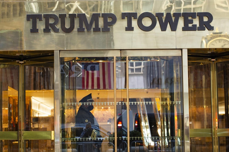 A security guard stands at the door of Trump Tower in New York.