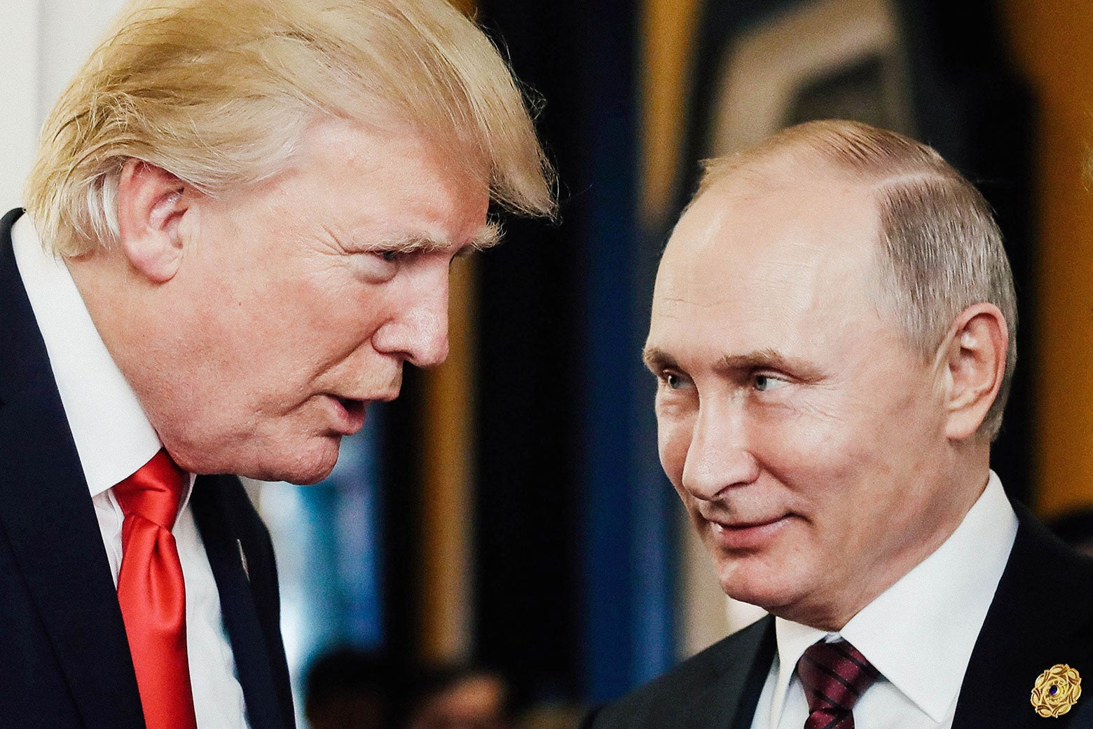 U.S. President Donald Trump chats with Russia's President Vladimir Putin as they attend the APEC Economic Leaders' Meeting in Da Nang, Vietnam, on Nov. 11.