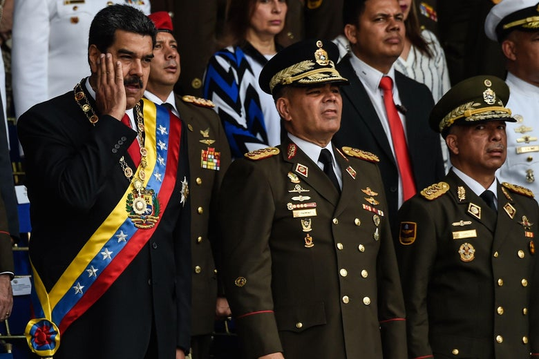 Venezuelan President Nicolas Maduro (L) gestures next to Minister of Defence General Vladimir Padrino (C), during a ceremony to celebrate the 81st anniversary of the National Guard in Caracas on August 4, 2018.