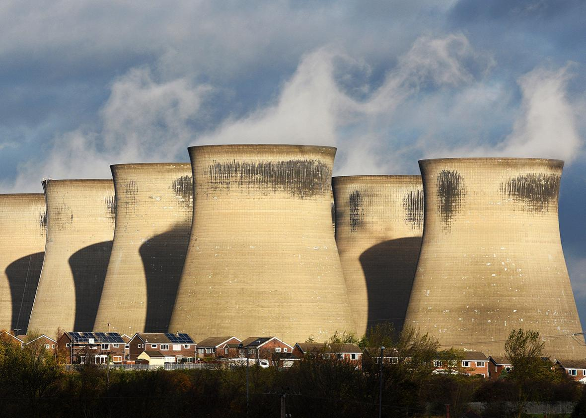 A general view shows a residential estate in front of the coal fired Ferrybridge C power station, near Knottingley in northern England, on November 10, 2015.