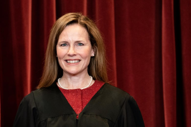 Associate Justice Amy Coney Barrett stands during a group photo of the Justices at the Supreme Court in Washington, DC on April 23, 2021.