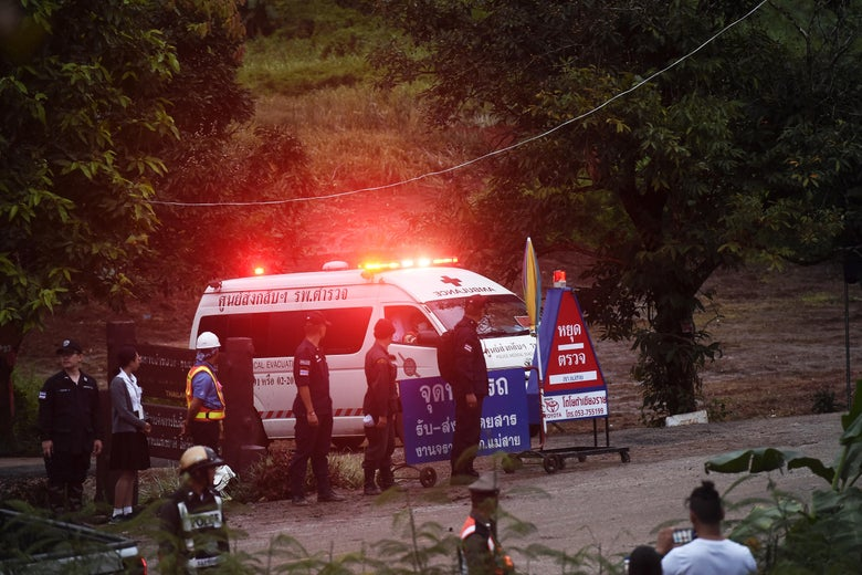 An ambulance leaves the Tham Luang cave area after divers evacuated some of the 12 boys and their coach trapped at the cave in Khun Nam Nang Non Forest Park in the Mae Sai district of Chiang Rai province on July 8, 2018.