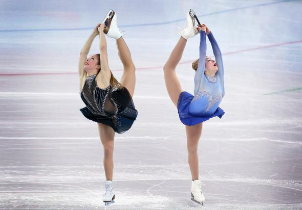 Left, Ashley Wagner of the United States competes in the Figure Skating Team Ladies Short Program; Gracie Gold of the United States competes in the Team Ladies Free Skating in Sochi, Russia, February 2014.