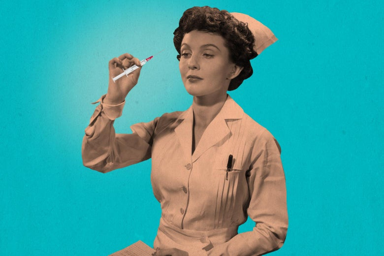 A nurse holds up a syringe.