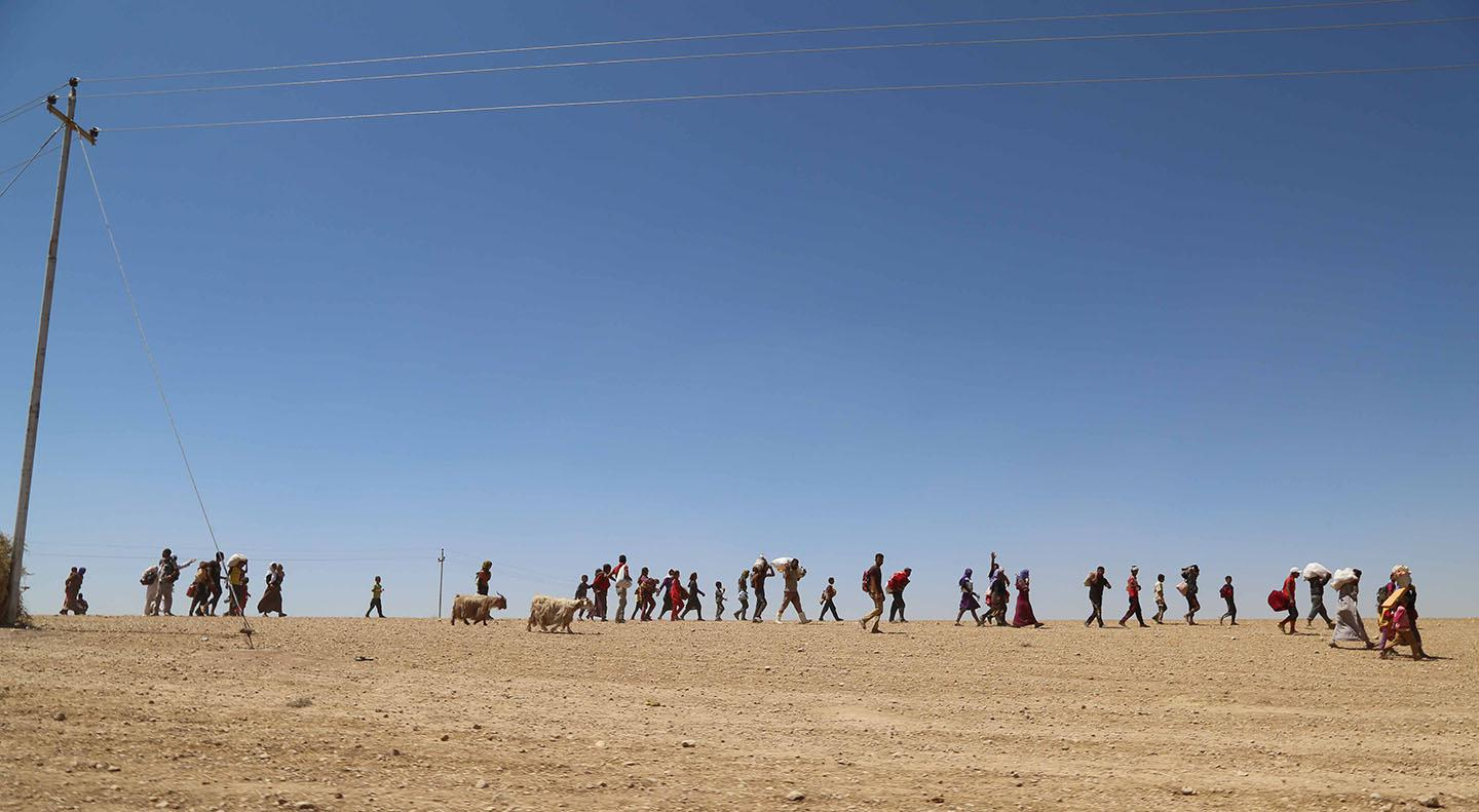 Yazidis trapped in the Sinjar mountains as they tried to escape from ISIS militants, are rescued by Kurdish Peshmerga forces and Peoples Protection Unit (YPG) in Mosul, Iraq on August 9, 2014.