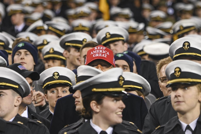 "A ""Keep America Great"" hat appears among a sea of military caps."