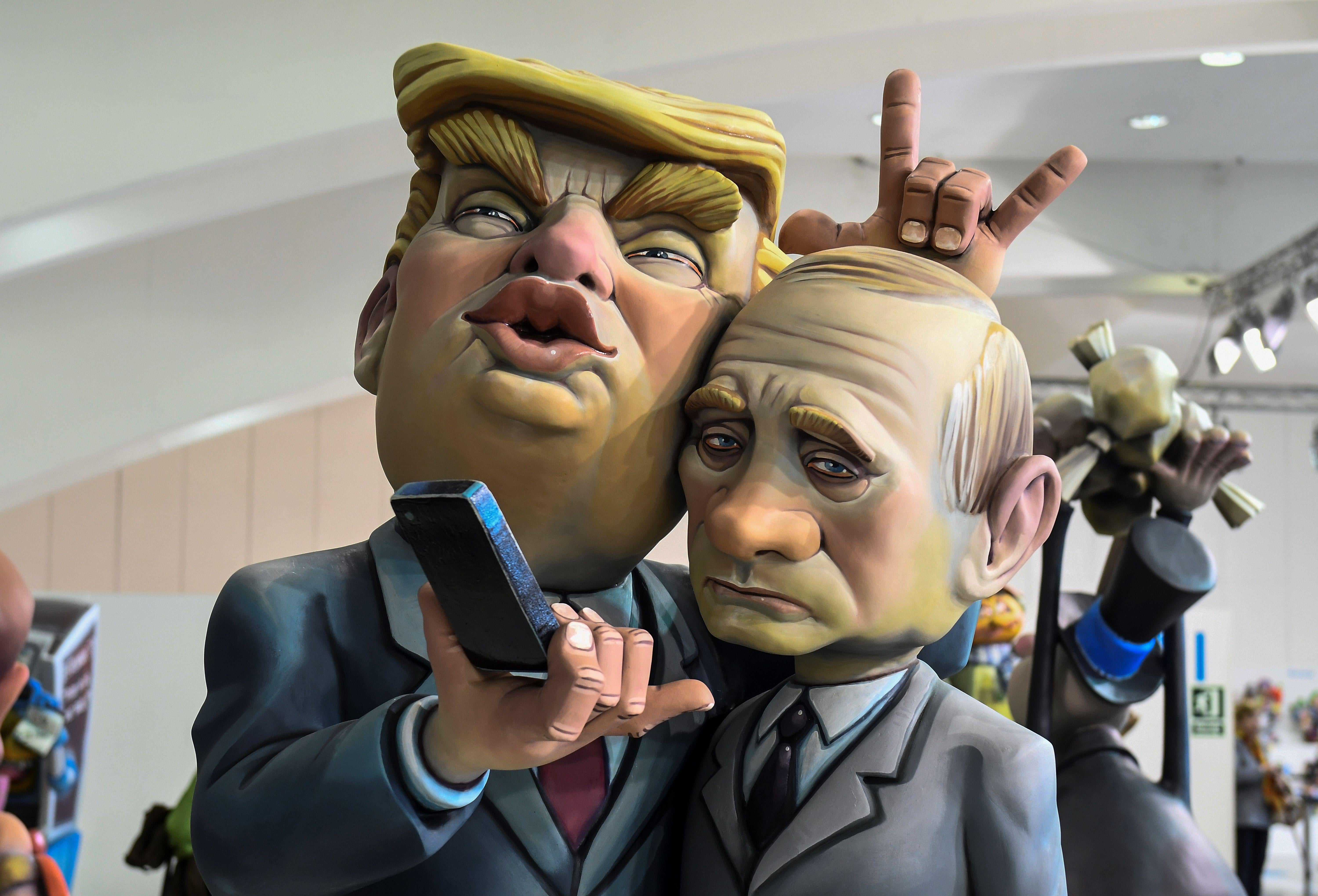 A Ninot, a doll depecting a celebrity that will be set alight during the Fallas festival, representing US President Donald Trump and Russian President Vladimir Putin is displayed in Valencia on March 09, 2018.         Fallas are gigantic structures made of cardboard portraying current events and presonalites in which individual figures or Ninots are placed. The Fallas will be burnt in the streets of Valencia on March 19, 2018 as a tribute to Saint Joseph, patron saint of the carpenters'guild. / AFP PHOTO / JOSE JORDAN        (Photo credit should read JOSE JORDAN/AFP/Getty Images)