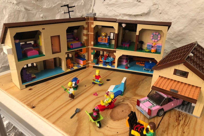 A photo of 742 Evergreen Terrace, in cross-section, showing such details as everyone's bedrooms, the iconic orange couch, and Ned Flanders