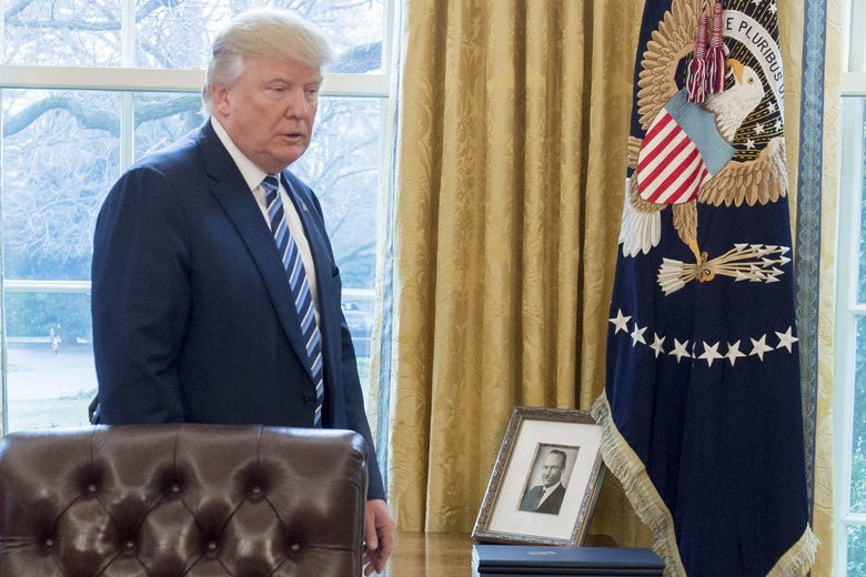 A photograph of Fred Trump, the father of US President Donald Trump, is seen in the Oval Office of the White House on February 9, 2017.